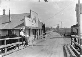 [Muriel Cornish, Wilfred Cornish, and Mary Tait on Marpole Bridge near Grauer's Store]