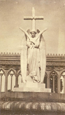 [Statue of an angel and a cross]