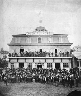 [Large group assembled in front of the Colonial Hotel, New Westminster, for B.C.'s 1st Domin...