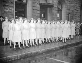 [Canadian Womens Army Corps (C.W.A.C.) stand at attention in front of the Federal Building]