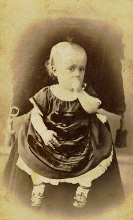 [Studio portrait of child sucking its thumb]