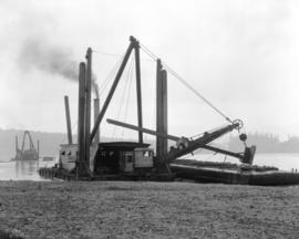 [Grant & McDonald steam shovel on barge filling in Heatley Avenue Wharf]