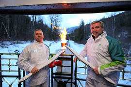 Day 90 Torchbearer 7 Randy Dudka and torchbearer 8 Fred Green stay warm beside the Olympic Flame