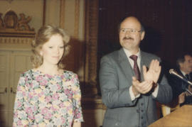 Mike Harcourt and unidentified woman at podium