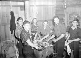 [Group of skiers making breakfast in Enquist Lodge, Mt. Seymour, B.C.]