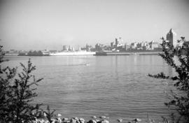 "[View of an ""Empress"" ship at dock and Downtown from Stanley Park]"