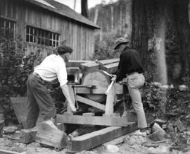 Green Point Logging Co. Ltd. [two men sharpening axes]