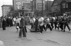 [Chinese parade crossing the 400 Block East Hastings Street during VJ Day celebrations]