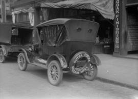 "Automobile with ""Gutta Percha Balloon Tires"" written on the spare"