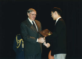 Governor General Romeo LeBlanc presents award to Paul Yee in Montreal