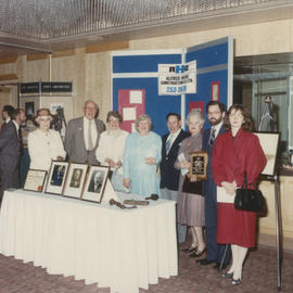 Group in front of Alfred Home Construction Co. Ltd. Display at Kiwanis Club Centennial luncheon