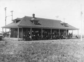 [A group of men in front of 'The Pavilion' at the Richmond Rifle Range on Lulu Island]