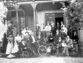 [Group assembled in front of a boarding house at 224 Georgia St. and Cambie St.]
