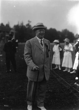 "B.C. Sugar Refinery picnic [man wearing ""Judge"" ribbon]"