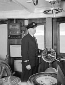 C.P.R. Captain [in the wheelhouse of the Princess Adelaide]