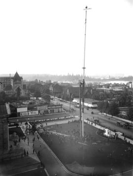 Erection of Courthouse flagpole - taken from Hotel Vancouver