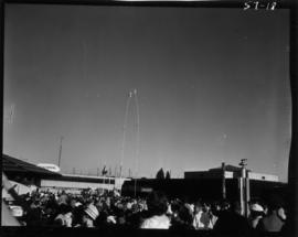 "Crowd watching performers on tall poles in ""Sky Kings"" 100 foot sway pole act, with P.N..."