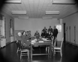 [Meeting of Red Cross officials in a board room]
