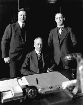 [Mayor L.D. Taylor in his office with Alderman W.W. Smith and unidentified man]