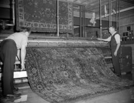 [Rug being cleaned at Nelsons Laundry]