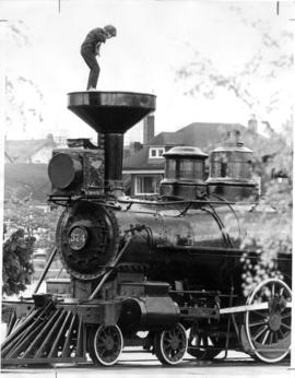 Child standing on old 374 C.P.R. engine at Kitsilano Beach