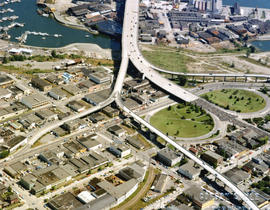 Aerial view of Fairview at the foot of Granville Street Bridge, with Granville Island and industr...
