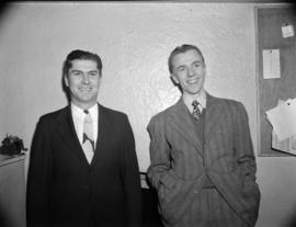 [Portrait of two staff members of the Vancouver News-Herald sports department]