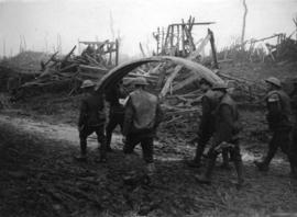 [Soldiers carry the roof of a dug-out on the Western Front]