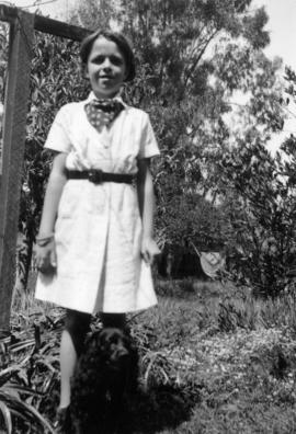 Mary Louise Taylor [standing outside with dog]