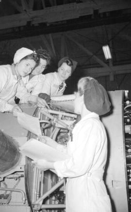 [Women working on airplane at the Boeing plant on Sea Island]
