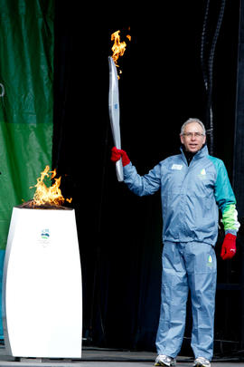 Day 1 torchbearer 1 Arnold Boldt lights the Paralympic Torch from the cauldron in Ottawa, Ont.