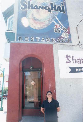 Woman at entrance to Shanghai Restaurant on Somerset Street, Ottawa