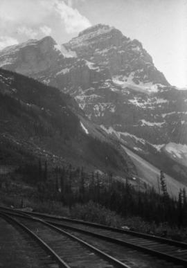 [View of a mountain from a railroad]