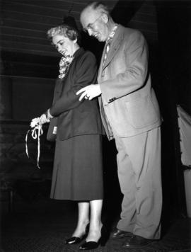 J.S.C. Moffitt and unidentified woman at driving range