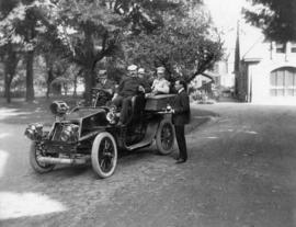 [Four men in an automobile with man standing next to car serving wine in Plainfield, New Jersey ]