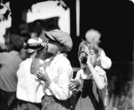Flag day at Exhibition [two boys drinking soda pop]