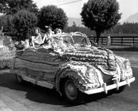 Children on decorated vehicle in 1947 P.N.E. Opening Day Parade