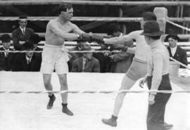 [A boxing match between Billy Weeks and Romeo Hagen]