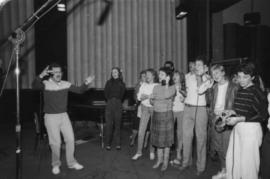 Group singing in recording studio at Griffiths Gibson Productions