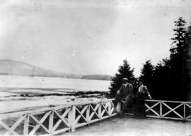 Man and woman on balcony of Jericho Clubhouse, looking across beach to north shore