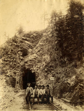 Tunnel near Yale B.C. [with men sitting on handcar]