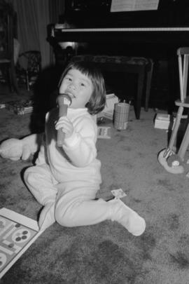 Young girl playing in a living room