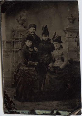 Three women and a man including Harriet Ellen Lee posed in outdoor clothes in a photographer&#039...