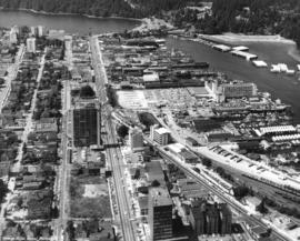 [Aerial photograph of downtown Vancouver and Burrard Inlet waterfront]