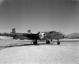 [Water bomber being loaded at the Cranbrook Airport]