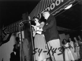 Nancy Hansen on Outdoor Theatre stage with P.N.E. director after being named Miss P.N.E. 1954