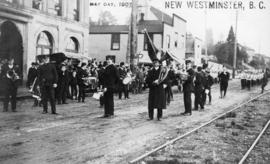 [Band members standing on road], May Day, New Westminster, B.C.