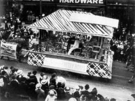 [The Pacific Box Company float in the 600 Block of Granville Street during a Victoria Day parade]