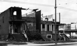 [Houses being demolished on the west side of the 1100 block Howe Street looking north]