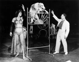 Cimse's Russian wolf-hounds and Pomeranians : [publicity photo of circus performers and dogs]